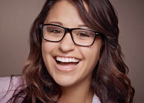 smiling woman with glasses
